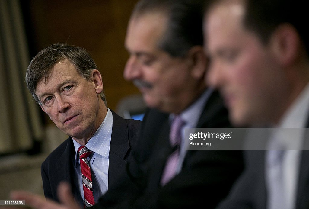 John Hickenlooper, governor of Colorado, left, and Andrew Liveris, chairman and chief executive officer of Dow Chemical Co., center, listen as Ross Eisenberg, vice president of energy and resources policy at the National Association of Manufacturers, speaks during a Senate Energy and Natural Resources Committee hearing in Washington, D.C., U.S., on Tuesday, Feb. 12, 2013. The top two members of a Senate committee for energy split over expanding U.S. natural gas exports, mirroring a disagreement between fuel consumers such as Dow Chemical Co. and producers such as Exxon Mobil Corp. Photographer: Andrew Harrer/Bloomberg via Getty Images
