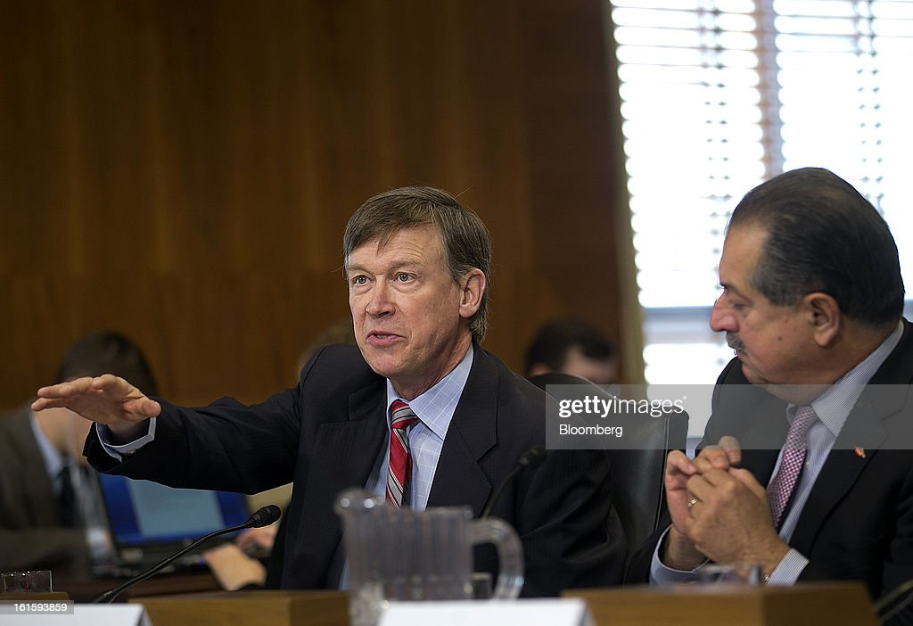 <a gi-track='captionPersonalityLinkClicked' href=/galleries/search?phrase=John+Hickenlooper&family=editorial&specificpeople=4104050 ng-click='$event.stopPropagation()'>John Hickenlooper</a>, governor of Colorado, left, speaks during a Senate Energy and Natural Resources Committee hearing while Andrew Liveris, chairman and chief executive officer of Dow Chemical Co., listens in Washington, D.C., U.S., on Tuesday, Feb. 12, 2013. The top two members of a Senate committee for energy split over expanding U.S. natural gas exports, mirroring a disagreement between fuel consumers such as Dow Chemical Co. and producers such as Exxon Mobil Corp. Photographer: Andrew Harrer/Bloomberg via Getty Images