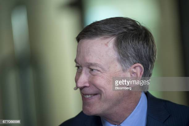 John Hickenlooper governor of Colorado reacts during a Bloomberg Television interview at the Milken Institute Global Conference in Beverly Hills...