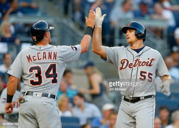 John Hicks and James McCann of the Detroit Tigers in action against the New York Yankees at Yankee Stadium on August 1 2017 in the Bronx borough of...