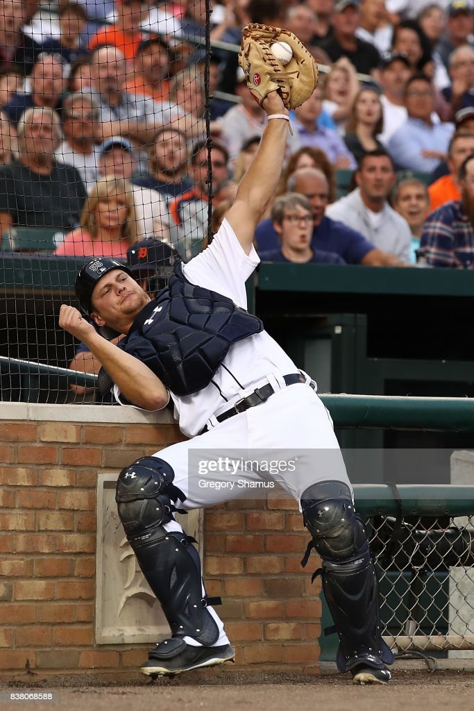 John Hicks #55 of the Detroit Tigers catches a Todd Frazier #29 of the New York Yankees third inning foul ball at Comerica Park on August 23, 2017 in Detroit, Michigan.