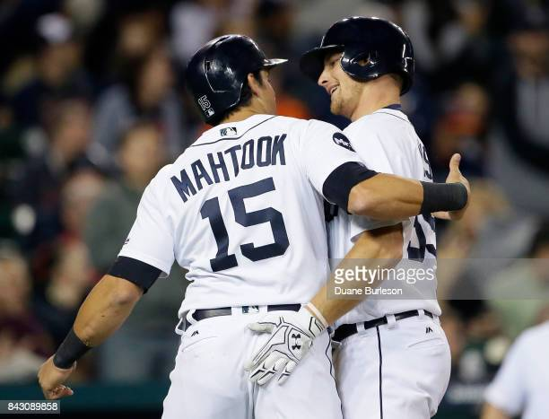 John Hicks of the Detroit Tigers celebrates with Mikie Mahtook of the Detroit Tigers after hitting a tworun home run against the Kansas City Royals...