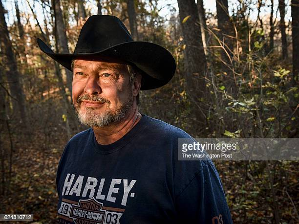 John Hicks who survived an ordeal in the woods after his flight instructor crashed their small plane two years ago shown in the woods where he...