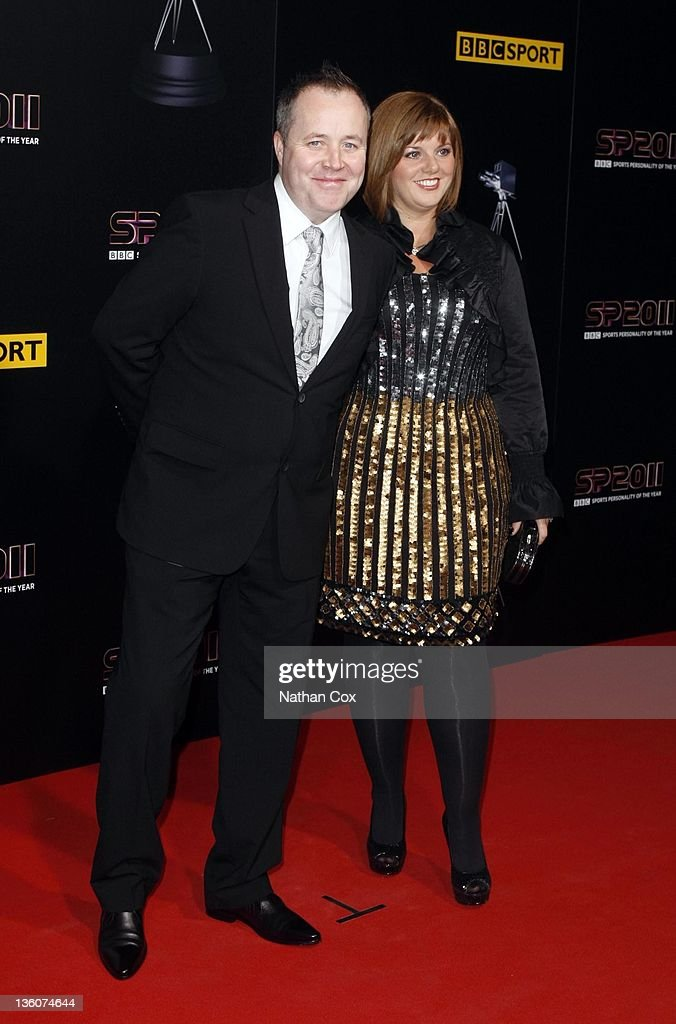 <a gi-track='captionPersonalityLinkClicked' href=/galleries/search?phrase=John+Higgins&family=editorial&specificpeople=228132 ng-click='$event.stopPropagation()'>John Higgins</a> and his wife Denise Higgins attend the awards ceremony for BBC Sports Personality of the Year 2011 at Media City UK on December 22, 2011 in Manchester, England.