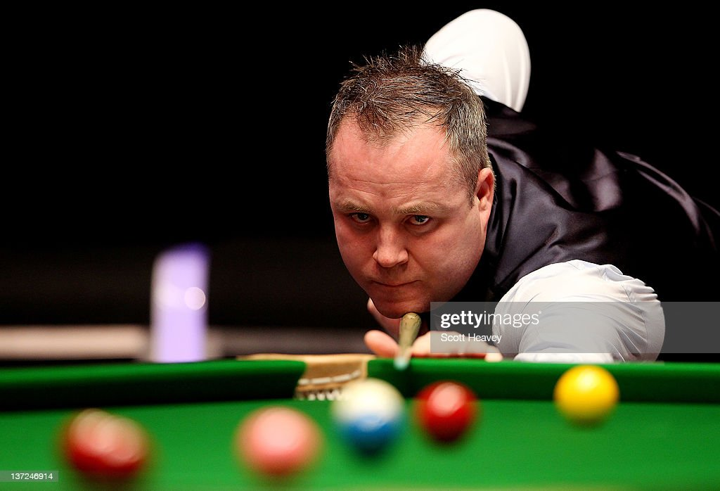 <a gi-track='captionPersonalityLinkClicked' href=/galleries/search?phrase=John+Higgins&family=editorial&specificpeople=228132 ng-click='$event.stopPropagation()'>John Higgins</a> in action during his match with Matthew Stevens during day three of the The Masters at Alexandra Palace on January 17, 2012 in London, England.