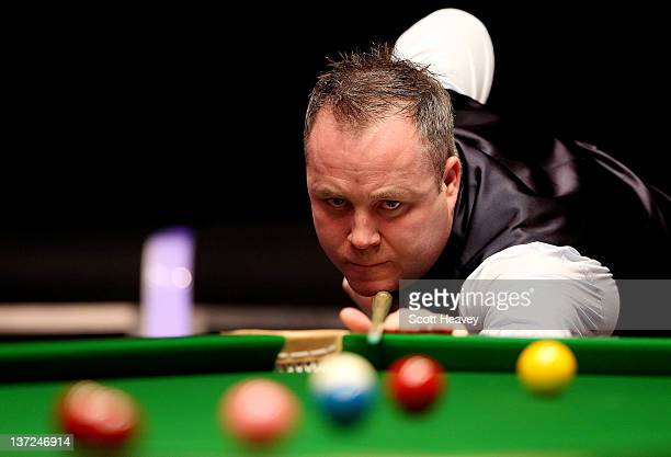 John Higgins in action during his match with Matthew Stevens during day three of the The Masters at Alexandra Palace on January 17 2012 in London...