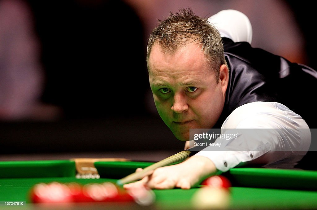 John Higgins in action during his match with Matthew Stevens during day three of the The Masters at Alexandra Palace on January 17, 2012 in London, England.