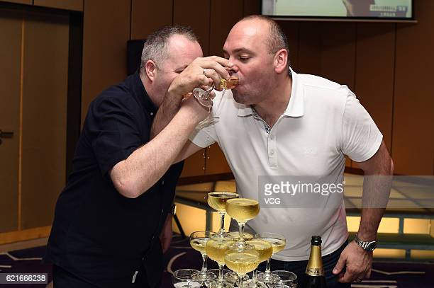 John Higgins of Scotland and Stuart Bingham of England attend the celebration party after the final match of of the Evergrande China Championship at...