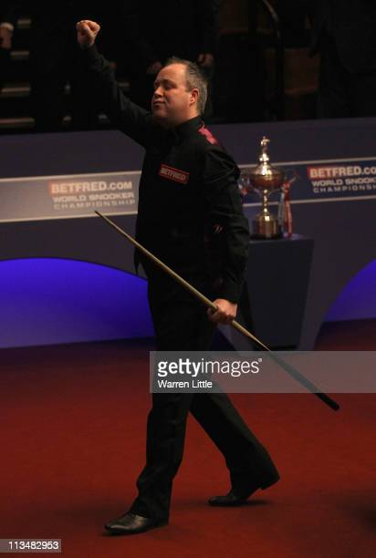 John Higgins of Scotland celebrates beating Judd Trump of England to win the Betfredcom World Snooker Championship at the Crucible Theatre on May 2...