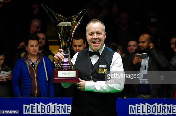 John Higgins of Scotland celebrates with the trophy after winning the final match against Martin Gould of England on day seven of 2015 Australian...