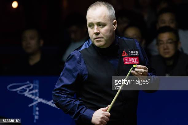 John Higgins of Scotland chalks the cue during the semifinal match against Ronnie O'Sullivan of England on day five of 2017 Shanghai Masters at...