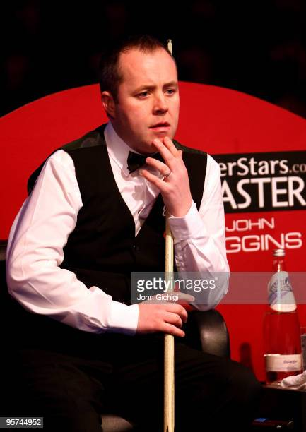 John Higgins of Scotland contemplates a shot in his match against Mark Allen of Ireland during the PokerStars Masters snooker tournament at Wembley...