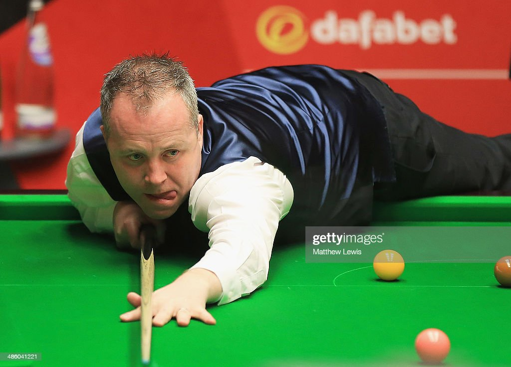 John Higgins of Scotland in action against Alan McManus of Scotland during day four of the The Dafabet World Snooker Championship at Crucible Theatre on April 21, 2014 in Sheffield, England.