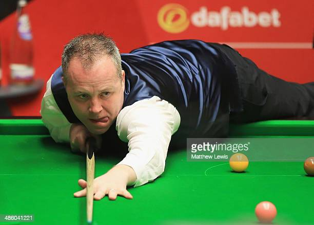 John Higgins of Scotland in action against Alan McManus of Scotland during day four of the The Dafabet World Snooker Championship at Crucible Theatre...