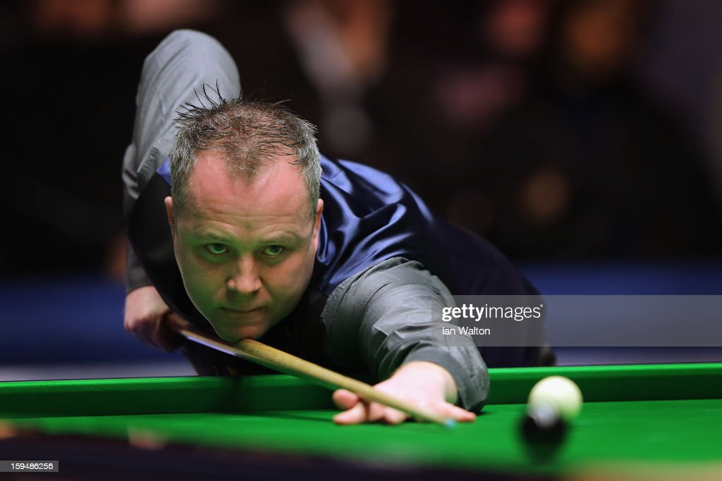 John Higgins of Scotland in action during his first round match against Ali Carter of England at Alexandra Palace on January 14, 2013 in London, England.