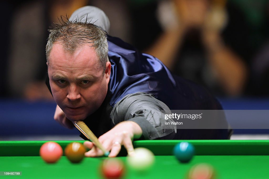 <a gi-track='captionPersonalityLinkClicked' href=/galleries/search?phrase=John+Higgins&family=editorial&specificpeople=228132 ng-click='$event.stopPropagation()'>John Higgins</a> of Scotland in action during his first round match against Ali Carter of England at Alexandra Palace on January 14, 2013 in London, England.