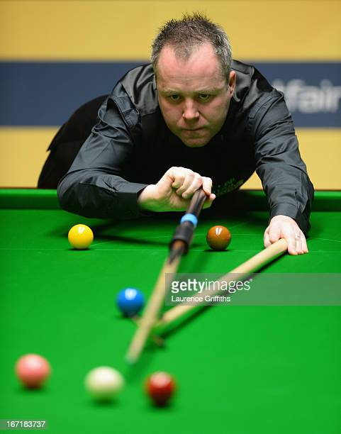 John Higgins of Scotland in action during his first round match against Mark Davis of England during the Betfair World Snooker Championship at the...