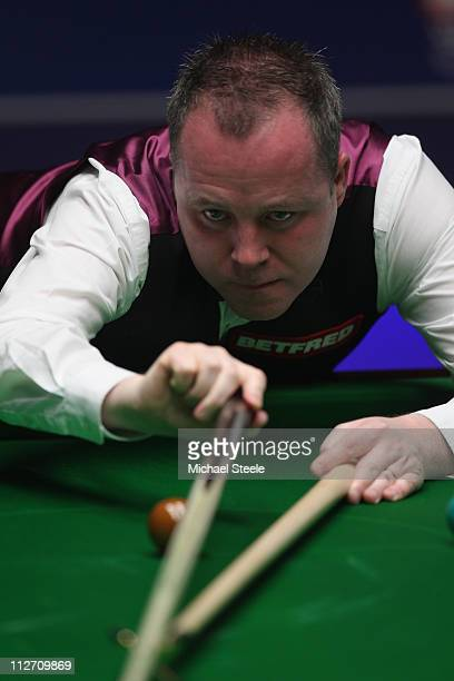 John Higgins of Scotland in the round one game against Stephen Lee of England on day five of the Betfredcom World Snooker Championship at The...