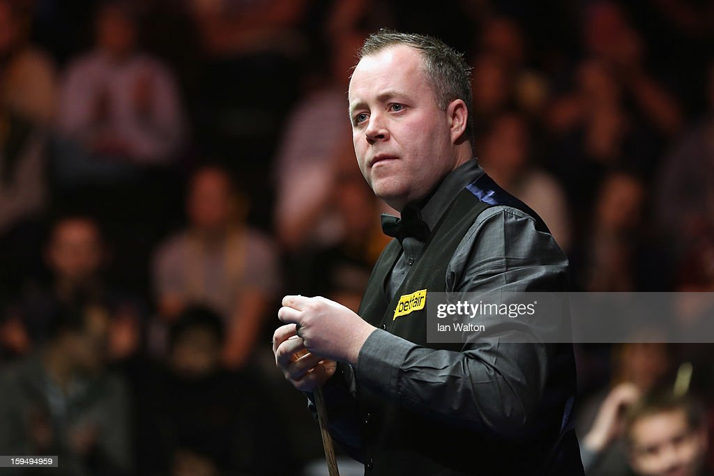 <a gi-track='captionPersonalityLinkClicked' href=/galleries/search?phrase=John+Higgins&family=editorial&specificpeople=228132 ng-click='$event.stopPropagation()'>John Higgins</a> of Scotland looks on during his first round match against Ali Carter of England at Alexandra Palace on January 14, 2013 in London, England.