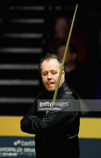 John Higgins of Scotland looks on during his first round match against Mark Davis of England during the Betfair World Snooker Championship at the...