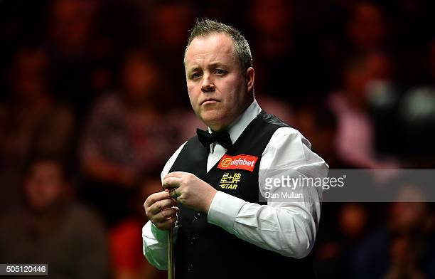 John Higgins of Scotland looks on during his quarter final match against Stuart Bingham of England during Day Six of The Dafabet Masters at Alexandra...
