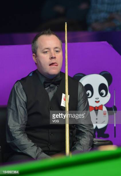 John Higgins of Scotland looks on in his match against Cao Yupeng of China on day two of the 2012 World Snooker International Championship at Sichuan...
