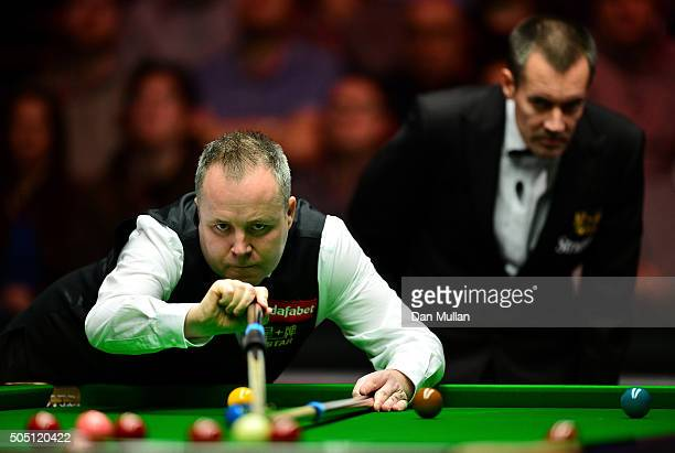 John Higgins of Scotland plays a shot during his quarter final match against Stuart Bingham of England during Day Six of The Dafabet Masters at...