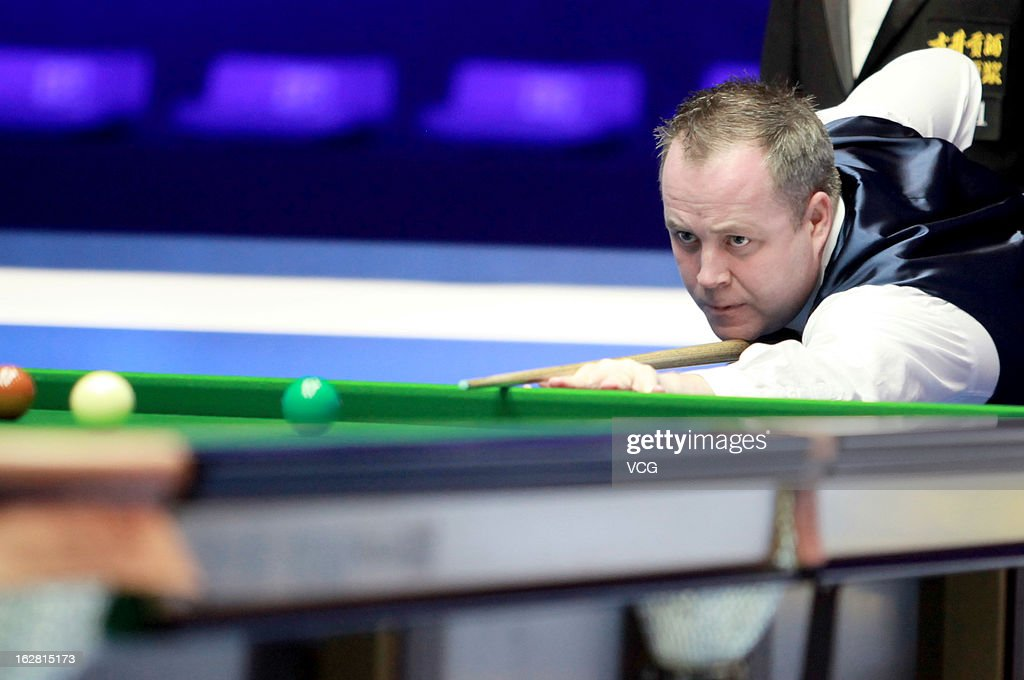 John Higgins of Scotland plays a shot during the match against Alan McManus of Scotland on day three of the 2013 World Snooker Haikou Open at Haikou Convention and Exhibition Center on February 27, 2013 in Haikou, China.