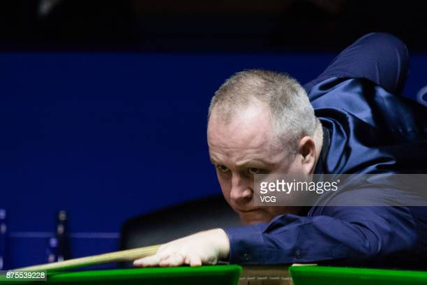John Higgins of Scotland plays a shot during the semifinal match against Ronnie O'Sullivan of England on day five of 2017 Shanghai Masters at...