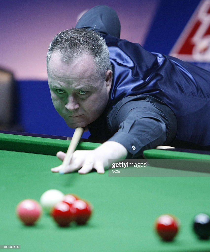 John Higgins of Scotland plays a shot in the match against Mark Davis of England on day four of the 2013 World Snooker Shanghai Master at Shanghai Grand Stage on September 19, 2013 in Shanghai, China.