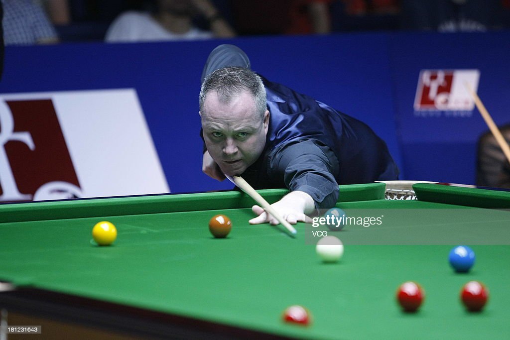 <a gi-track='captionPersonalityLinkClicked' href=/galleries/search?phrase=John+Higgins&family=editorial&specificpeople=228132 ng-click='$event.stopPropagation()'>John Higgins</a> of Scotland plays a shot in the match against Mark Davis of England on day four of the 2013 World Snooker Shanghai Master at Shanghai Grand Stage on September 19, 2013 in Shanghai, China.