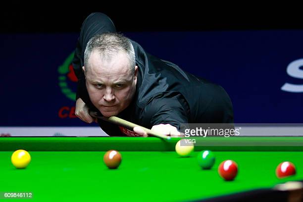 John Higgins of Scotland plays a shot in the second round match against Ali Carter of England on day four of the Shanghai Masters 2016 at Shanghai...