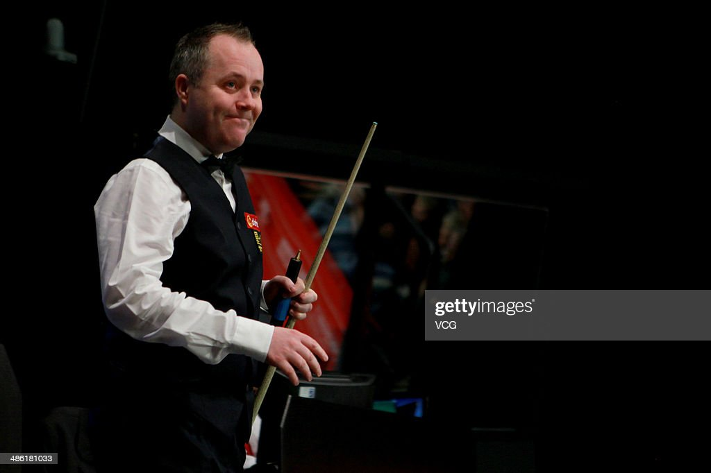 John Higgins of Scotland reacts against Alan McManus of Scotland during day four of the The Dafabet World Snooker Championship at Crucible Theatre on April 22, 2014 in Sheffield, England.