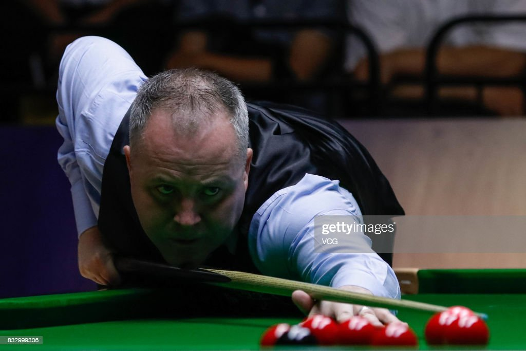 John Higgins of Scotland reacts during a qualifying match against Lyu Haotian of China on day one of Evergrande 2017 World Snooker China Champion at Guangzhou Sport University on August 16, 2017 in Guangzhou, Guangdong Province of China.