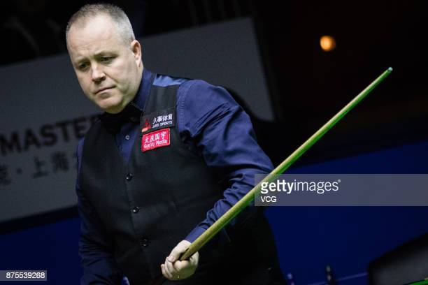 John Higgins of Scotland reacts during the semifinal match against Ronnie O'Sullivan of England on day five of 2017 Shanghai Masters at Shanghai...