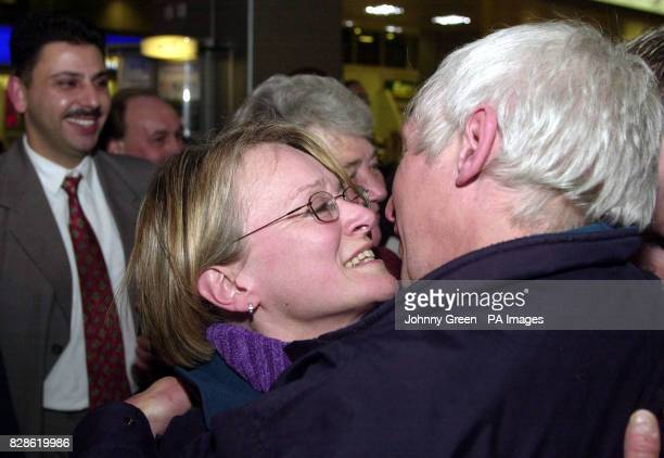 John Hingley from Devon is greeted by his wife as he arrives back in Britain at Heathrow Airport outside London after aiding David Haplin from Haytor...