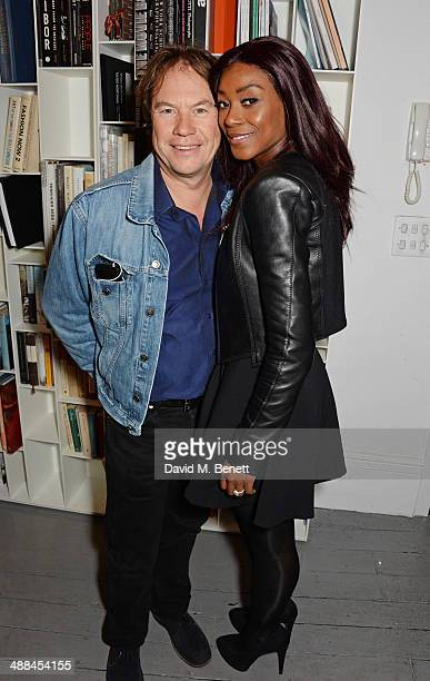 John Hitchcox and Phoebe Vela attend the launch of the new 'Jade Jagger' New Bond Street showroom on May 6 2014 in London England