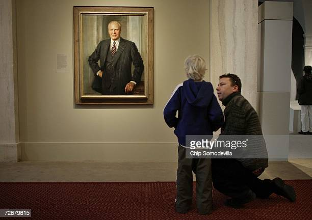 John Honeycutt and his son Drew Honeycutt of North Potomac Maryland look at the portrait of former US President Gerald R Ford at the National...