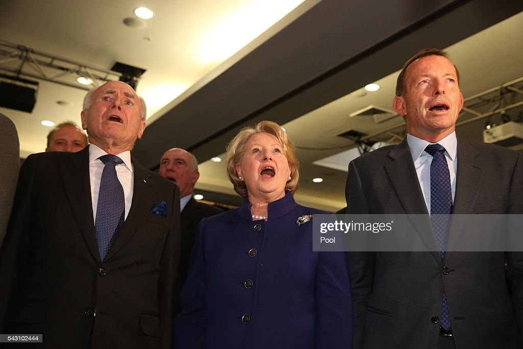 <a gi-track='captionPersonalityLinkClicked' href=/galleries/search?phrase=John+Howard+-+Politician&family=editorial&specificpeople=12204326 ng-click='$event.stopPropagation()'>John Howard</a>, <a gi-track='captionPersonalityLinkClicked' href=/galleries/search?phrase=Janette+Howard&family=editorial&specificpeople=220679 ng-click='$event.stopPropagation()'>Janette Howard</a> and <a gi-track='captionPersonalityLinkClicked' href=/galleries/search?phrase=Tony+Abbott&family=editorial&specificpeople=220956 ng-click='$event.stopPropagation()'>Tony Abbott</a> sing the National Anthem at the Coalition national campaign on June 26, 2016 in Sydney, Australia.