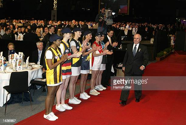 John Howard Prime Minister of Australia arrives at the Kangaroos Grand Final Breakfast held at Colonial Stadium ahead of the 2002 AFL Grand Final...