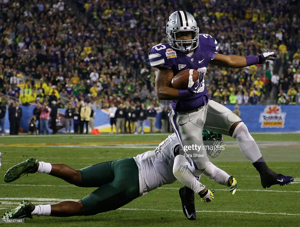 John Hubert #33 of the Kansas State Wildcats carries the ball against the Oregon Ducks during the Tostitos Fiesta Bowl at University of Phoenix Stadium on January 3, 2013 in Glendale, Arizona.