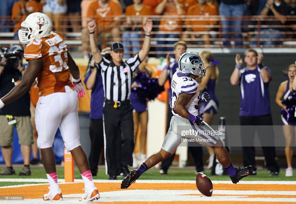 John Hubert #33 of the Kansas State Wildcats celebrates a touchdown against the Texas Longhorns at Darrell K Royal-Texas Memorial Stadium on September 21, 2013 in Austin, Texas.