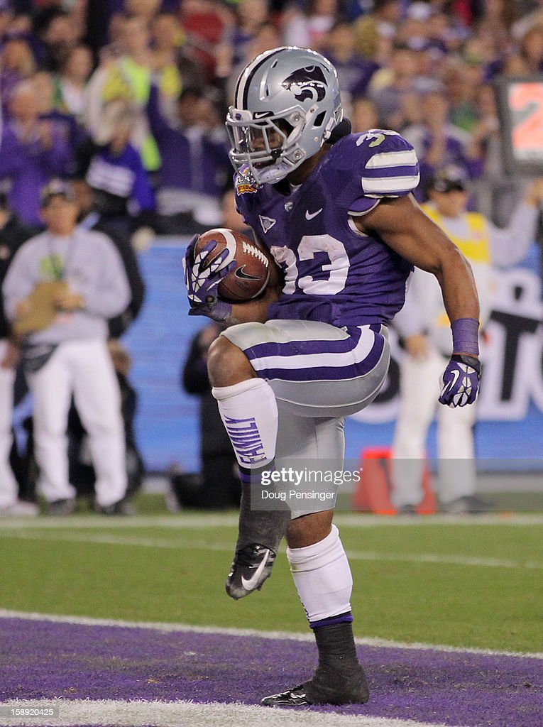 John Hubert #33 of the Kansas State Wildcats scores a touchdown on a 10 yard reception in the fourth quarter against the Oregon Ducks during the Tostitos Fiesta Bowl at University of Phoenix Stadium on January 3, 2013 in Glendale, Arizona.
