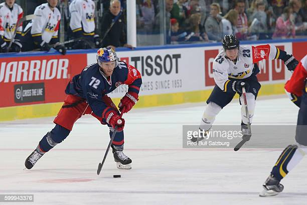 John Hughes of EC Red Bull Salzburg and Lias Andersson of HV71 Jonkoping during the Champions Hockey League match between Red Bull Salzburg and HV71...