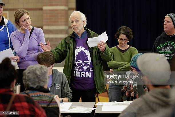 John Hughes talks about his candidate choice during Washington State Democratic Caucuses at Martin Luther King Elementary School in Seattle on March...