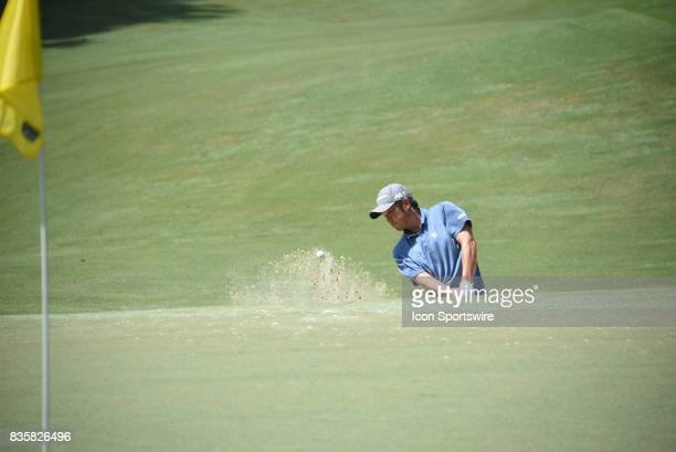 John Huh chips from the hazard on the 5th hole during the first round of the Wyndham Championship on August 17 2017 at Sedgefield Country Club in...