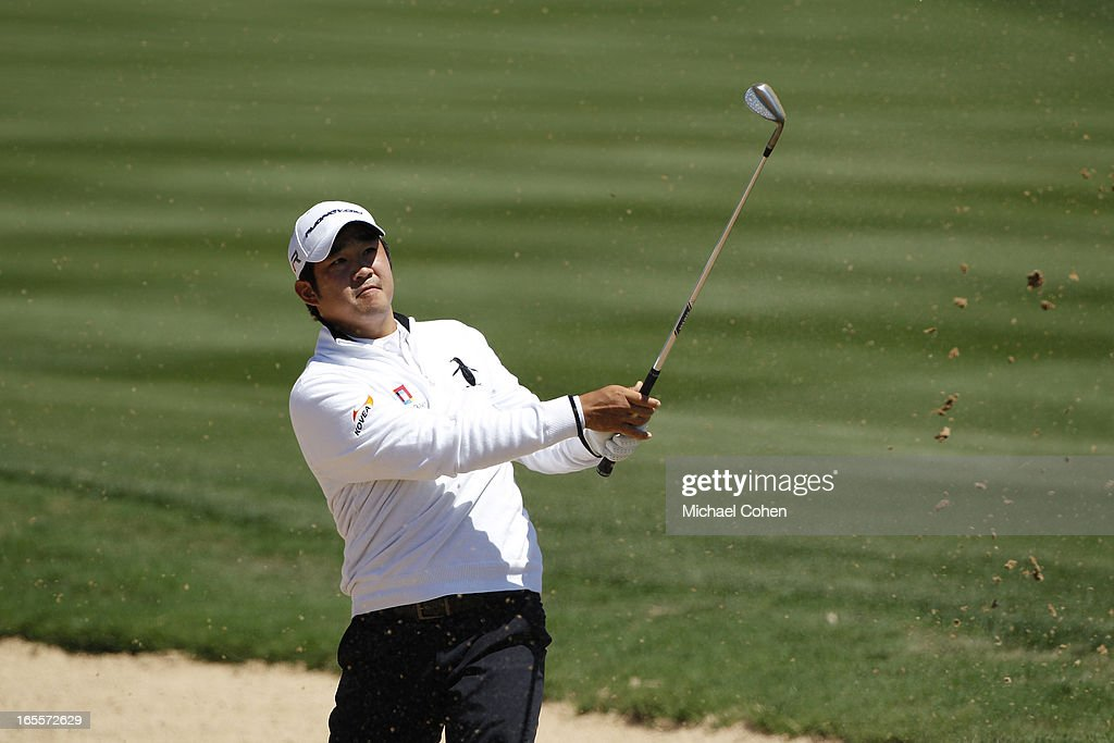 <a gi-track='captionPersonalityLinkClicked' href=/galleries/search?phrase=John+Huh&family=editorial&specificpeople=7338587 ng-click='$event.stopPropagation()'>John Huh</a> hits a shot from a bunker during the first round of the Valero Texas Open held at the AT&T Oaks Course at TPC San Antonio on April 4, 2013 in San Antonio, Texas.