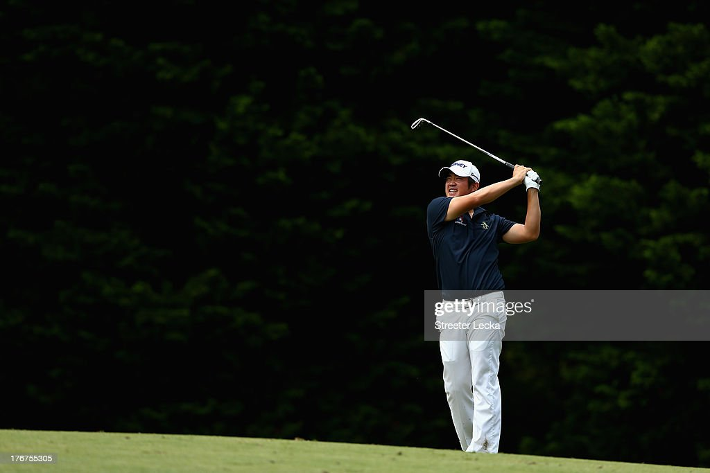 John Huh hits a shot on the 13th hole during the final round of the Wyndham Championship at Sedgefield Country Club on August 18, 2013 in Greensboro, North Carolina.