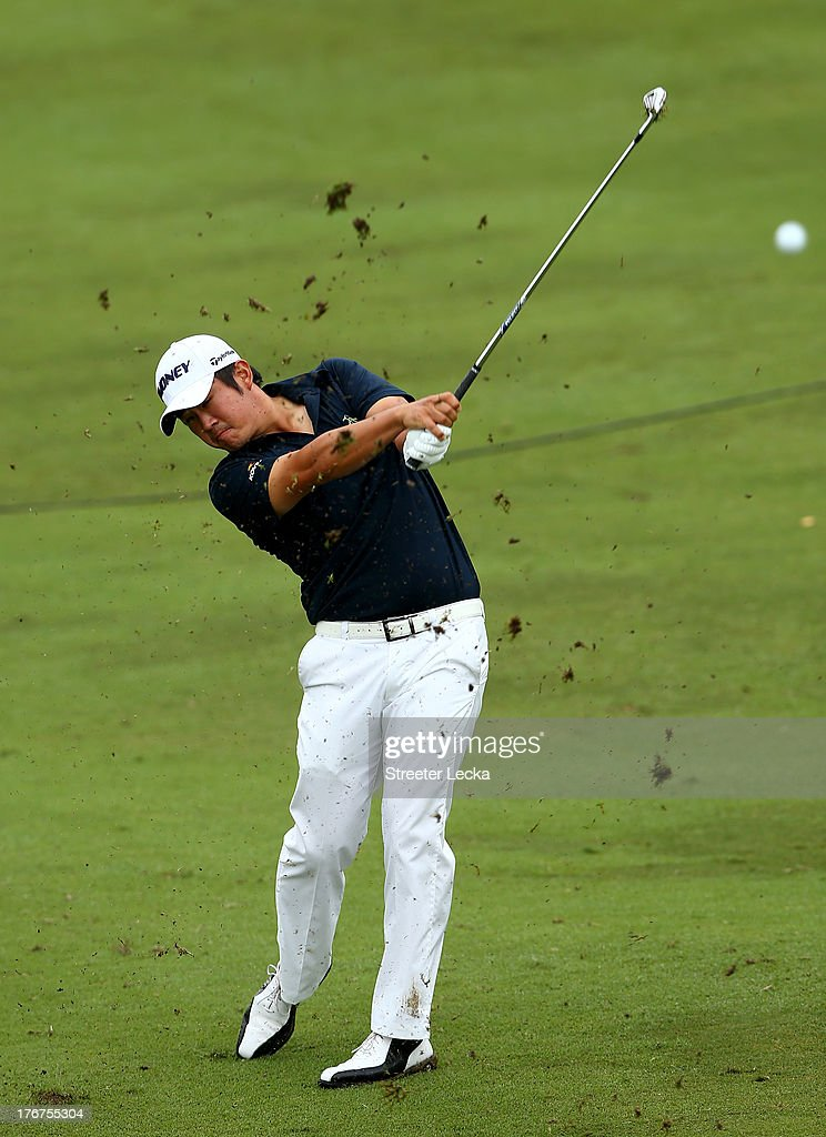 John Huh hits a shot on the 9th hole during the final round of the Wyndham Championship at Sedgefield Country Club on August 18, 2013 in Greensboro, North Carolina.