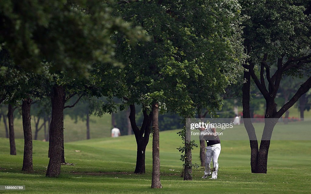 John Huh hits a shot out of the rough during the second round of the 2013 HP Byron Nelson Championship at the TPC Four Seasons Resort on May 17, 2013 in Irving, Texas.
